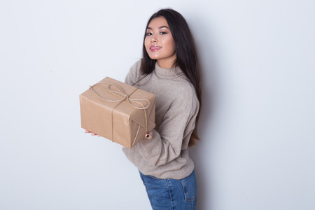 Secret present to you! Preparing gifts for special date. Girl gives a gift and enjoys Stock Photo