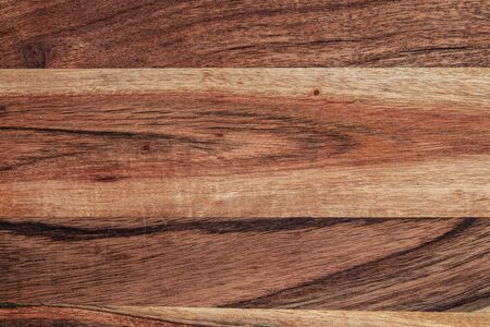 Acacia wood background close up - rich grain texture