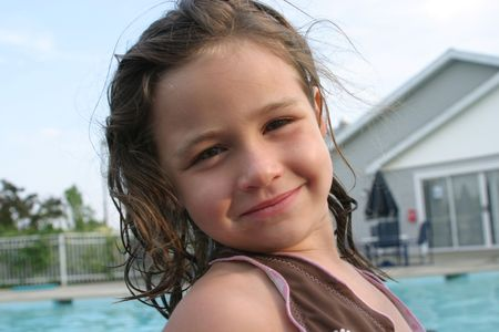 brown haired girl: 6 year old girl at the pool