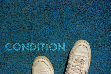 New life concept, Sport shoes and the word CONDITION written on blue walk way ground, Motivational slogan. Stock fotó