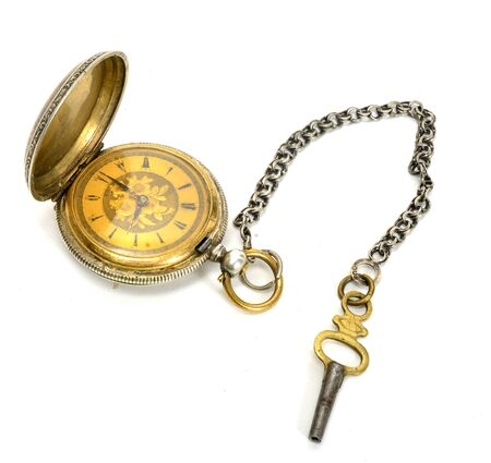 Old golden pocket watch isolated on white background