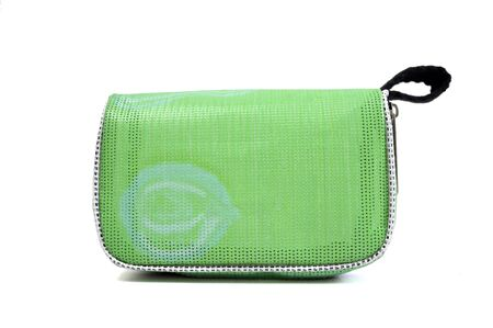 White background isolated and green handbag.