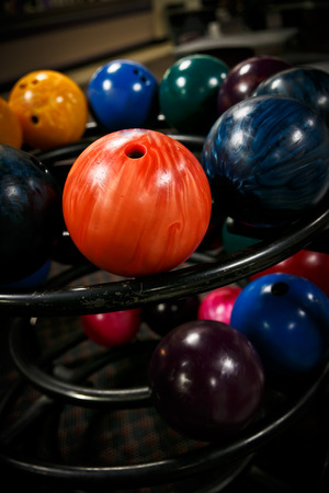 rule of thirds: Brightly colored bowling balls, on their rack,  using the rule of thirds. Stock Photo