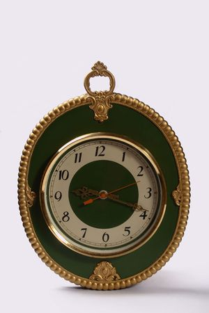 old green clock one white photo