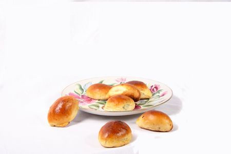 butter icing: russian fried pies on big plate isolated