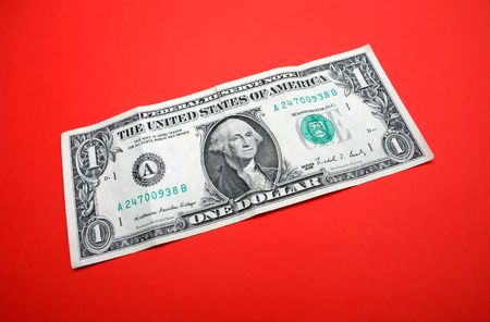 one dollar bill on red background