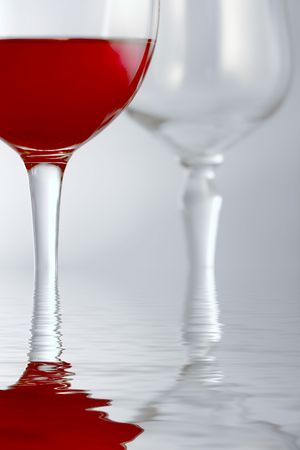 A glass of red drink with soft light and additional effect