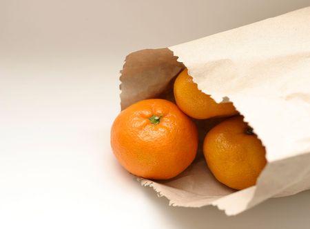 cake pick: tangerine in paper bag