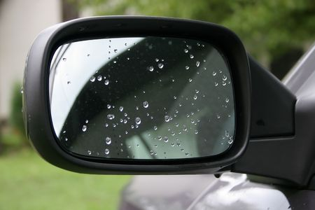visible: rain drops on rear view mirror, stains from dried drops visible