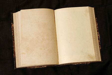 Old 19th century book open on both blank pages with stains and scratches. Stock Photo