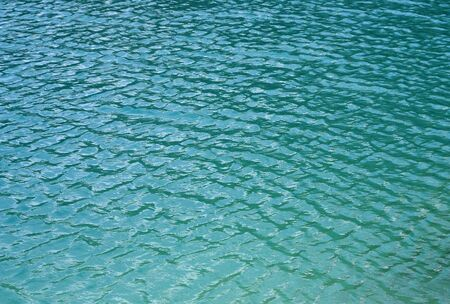 green and blue water surface with wrinkles