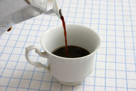 coffees: pouring black coffee from caffettiera