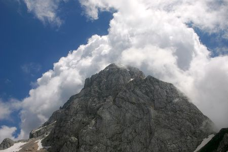 mountain top with white clouds Stock Photo