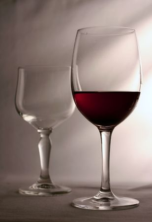 one glass empty other one full