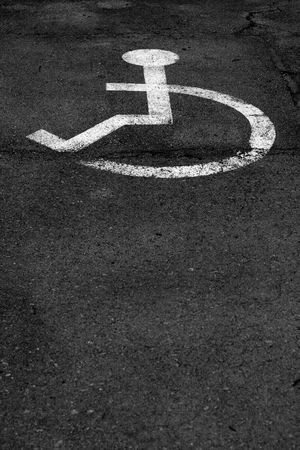 parking sign for disable people on the road photo