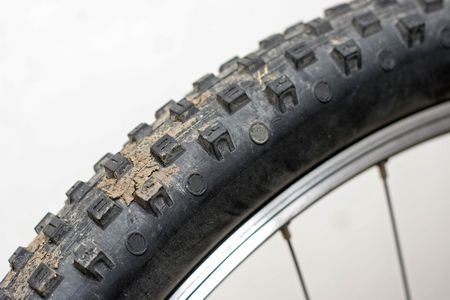 mountain bike tyre with mud on Stock Photo