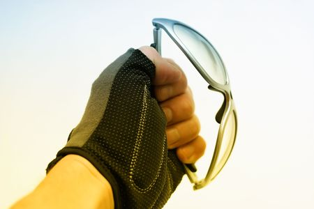 sunglasses in hand Stock Photo