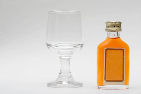 small bottle with glass Stock Photo