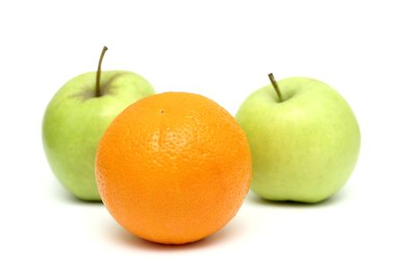 differentiate: apples and oranges mixed, orange standin out from the crowd Stock Photo