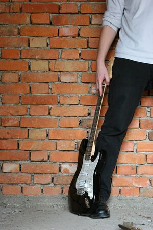 holding electric guitar Stock Photo