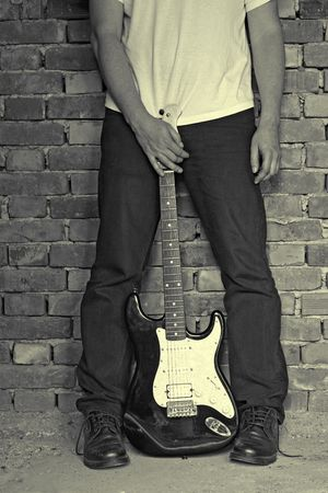 man holding electric guitar, grunge colors Stock Photo - 7003370