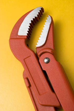 red water pump pliers on yellow background Stock Photo - 7003368