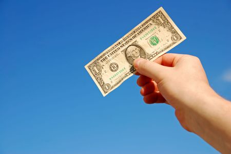 hand holding one US dollar against blue sky Stock Photo - 7168586