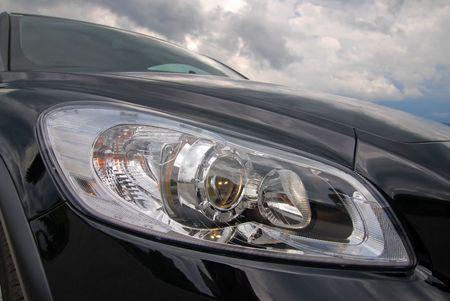 modern european car headlight against stormy sky Stock Photo - 7392807