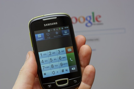 Zagreb, Croatia - June 25, 2012 - Samsung smart phone showing telephone interface keypad with Google website in the background Stock Photo - 14200392