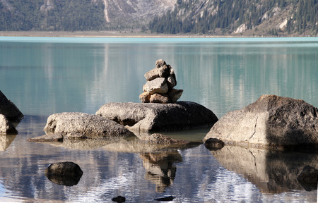 Sacred Lake in Tibet with a stupa made of stones