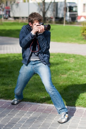 Photographer Takes a Shot by standing