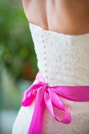 pink bow on wedding dress Stock Photo
