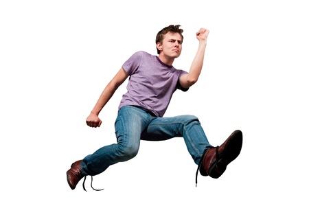 young man in jeans run away Standard-Bild