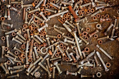 a lot of rust bolts and nuts photo