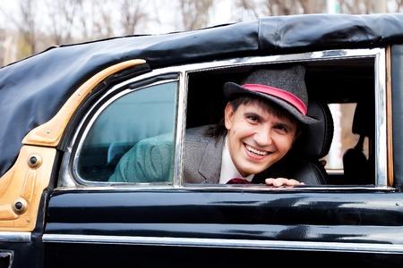 smile happy groom in retro car