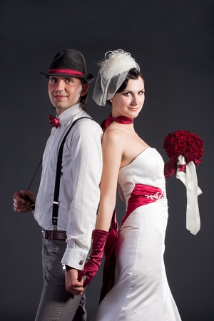 Beautiful wedding couple in retro style in studio photo