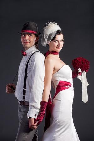 Beautiful wedding couple in retro style in studio photo