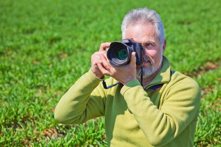 Man Holding Camera Stock Photo