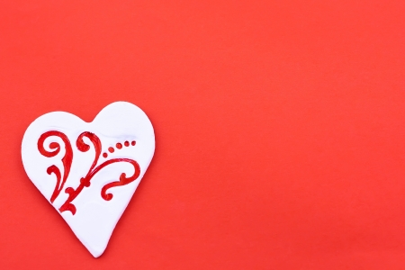 White heart-shaped candy on the red background Stock Photo - 16933642