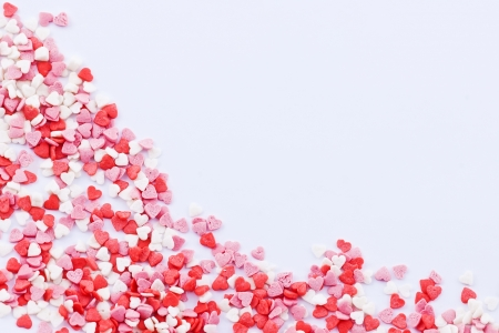 Frame made of small colored hearts on the white background Stock Photo - 16933648