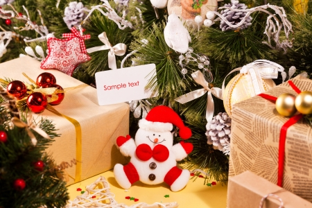Christmas decorations with gifts, toy snowman and greeting card Stock Photo - 16933655