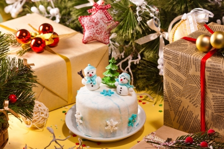 Christmas decorations with gifts and tasty cake Stock Photo - 16933653