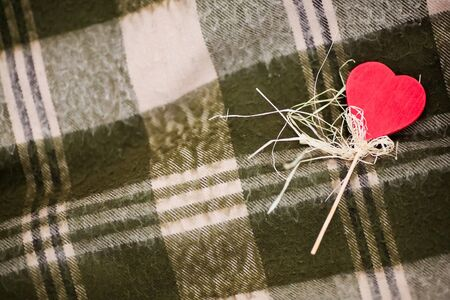 Red heart-shaped candy on the checked plaid Stock Photo - 16933650