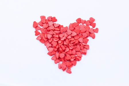 Heart shape consists of small read hearts on the white background Stock Photo - 16933641