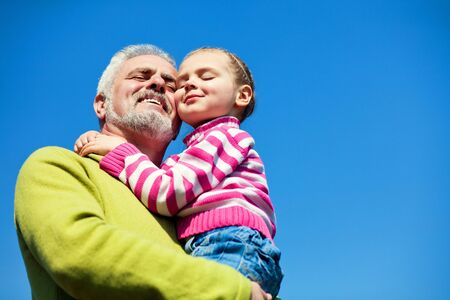 Grandfather and granddaughter happy together Stock Photo