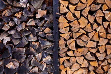 Background of dry chopped firewood logs stacked up on top of each other in a pile Stock Photo - 17176521