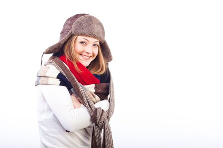 Studio shot of beautiful smiling woman isolated on white background with crossed arms wearing different scarfs and hat photo
