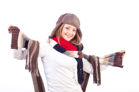 Studio shot of beautiful smiling woman isolated on white background wearing different scarfs and hat