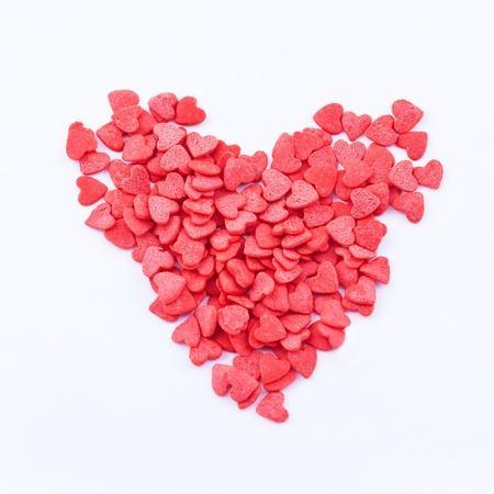 Heart shape consists of small read hearts on the white background Stock Photo - 17248935