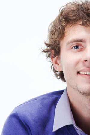half the face of a curly businessman smiling Stock Photo